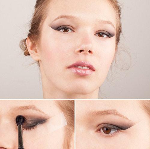 8. Meo đánh mắt với băng dính: Chị em hãy dùng một miếng băng dính nhỏ dán chéo ở phần đuôi mắt như trong hình và đánh mắt như bình thường. Sau đó, bạn bóc băng dính và và có được khối màu cực kỳ sắc nét, đẹp mắt.
