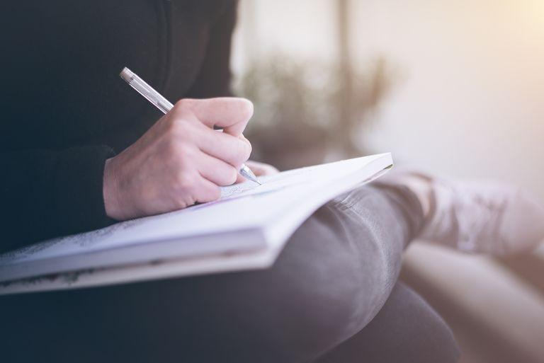 close up of person writing in book 733472809 5a7e17f01f4e1300373ec8f7