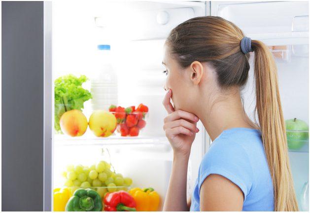 girl looking in fridge