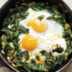skillet baked eggs with spinach yogurt and chili oil