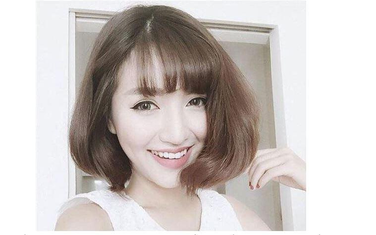 Tóc ngắn uốn phồng giúp che đi những khuyết điểm trên khuôn mặt tròn trịa